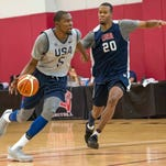 USA guard Kevin Durant (5) moves with the ball while being defended by forward Rodney Hood (20) during a practice at Mendenhall Center.