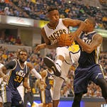 Pacers #33 Myles Turner rebounds the ball in first half action during the Utah Jazz at Indiana Pacers game, Saturday, October 31, 2015.