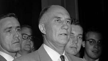 Republican Sen. Strom Thurmond of South Carolina leaves the Senate floor after staging a record 24-hour, 18-minute nonstop filibuster against a civil rights bill in 1957.