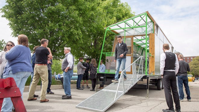 The public got a chance to see a mobile greenhouse to be used by Butler University's Center for Urban Ecology farm in Indianapolis on Tuesday on Ball State's campus. CUE received a $50,000 grant from Butler and partnered with BSU architecture students to build the fully automated greenhouse.