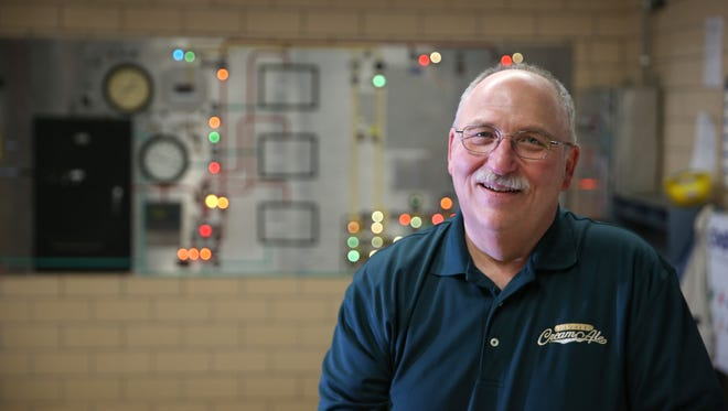 Genesee brewmaster Mike Mueller is retiring after 41 years at the brewery. He is seen in the old brew house at the St. Paul Street brewery.