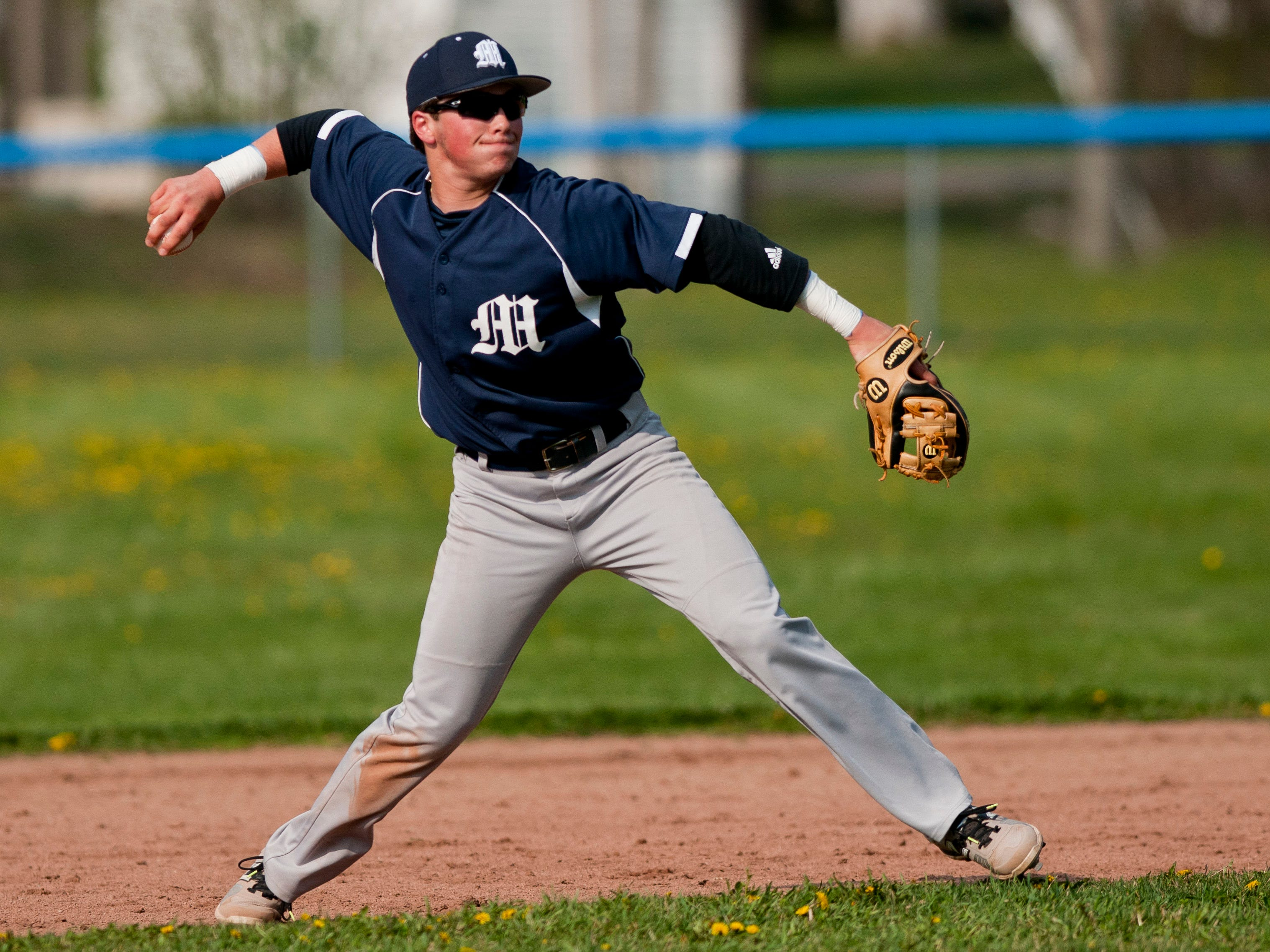 Marysville's Phill Griffor throws the ball to first during a baseball game Wednesday, May 6, 2015 at St. Clair High School.
