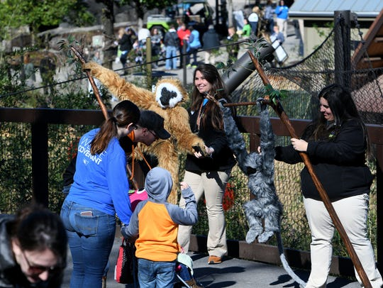 Zoo Knoxville employees entertain guests as they arrive for the ceremonial opening of new natural habitats Gibbon Trails and Langur Landing, part of the Asian Trek area Friday, March 2, 2018.