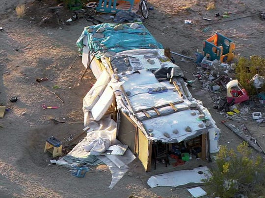This aerial photo from video provided by KABC-TV shows a ramshackle structure where authorities say a couple, their three children and dozens of cats were living in filthy conditions in unincorporated Joshua Tree in Southern California's Mojave Desert on Thursday, March 1, 2018. The San Bernardino County Sheriff's Department says 73-year-old Daniel Panico and 51-year-old Mona Kirk were arrested Wednesday, Feb. 28, on charges of child cruelty. (KABC-TV via AP)