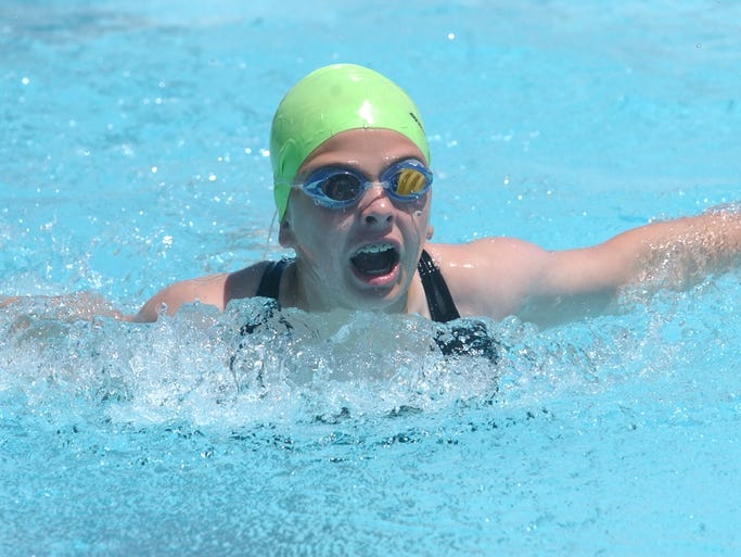 Mountain Home Hurricanes swimmer Bella Bevel competes in a butterfly event.