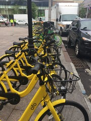 Dockless bike share two-wheelers line Mamaroneck Avenue