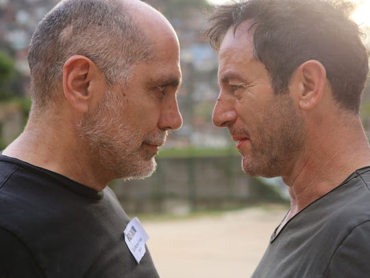 Director Guillermo Arriago (left) and actor Jason Isaacs