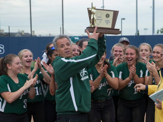 South Plainfield Coach Don Panzarella holds up their trophy and celebrates with his team. South Plainfield Softball wins nail biter over Steinert in Group III Championship at Kean University in Union NJ on June 4, 2017.