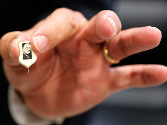 Mayor Tony Roswarski displays a Franklin D. Roosevelt stick pin Thursday, March 26, 2015, in his office inside Lafayette City Hall. The pin is part of Roswarski's collection of political memorabilia. The majority of Roswarski's collection is focused on the Kennedys.