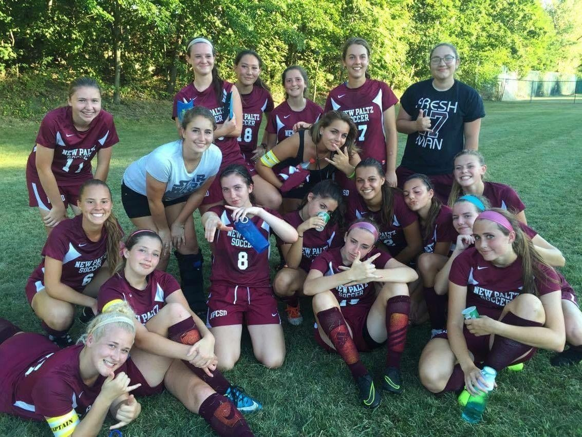 Alexis Garcia, center, poses with New Paltz High School soccer teammates after a game against Highland on Sept. 7, 2016.