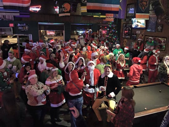 Head downtown for the annual Invasion of the Santas pub crawl.