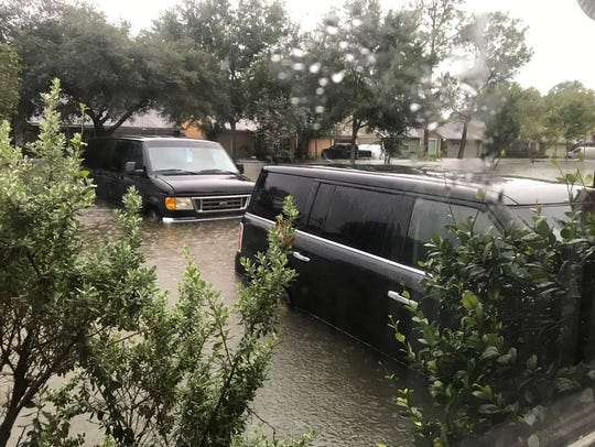 Flood waters destroyed homes and vehicles Sunday in