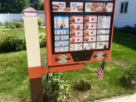 A vintage A & W order board in among the vintage items