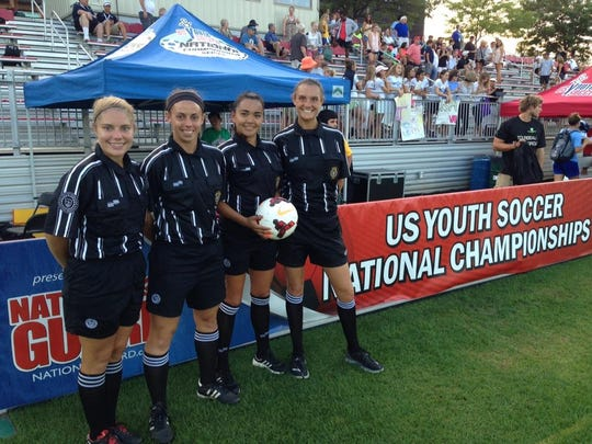 Stewarts Creek boys soccer coach Brooke Mayo (second from left) is shown at a youth national tournament, where she was a referee. She was recently named a FIFA assistant referee.