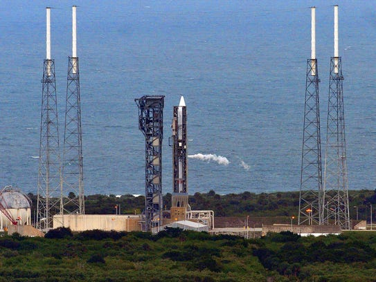An Atlas V rocket sits on the pad at Cape Canaveral