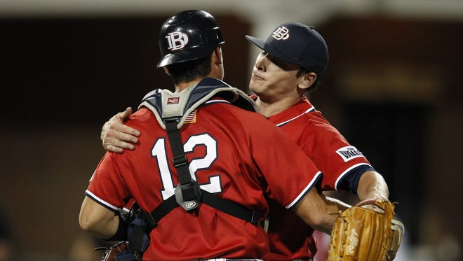 Dallas Baptist catcher Daniel Salters and pitcher Drew Smith, right, celebrate after defeating Oregon State on May 31, 2015.