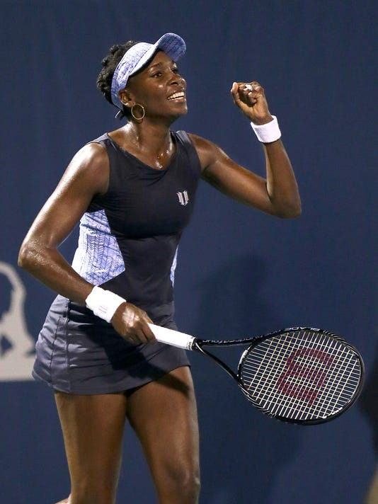 Venus Williams celebrates after beating Victoria Azarenka, from Belarus, 6-4, 7-6(1) in their match in the Bank of the West Classic tennis tournament in Stanford, Calif., Thursday, July 31, 2014. (AP Photo/Jeff Chiu)