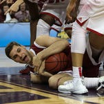 Bellarmine's Jake Thelen (12) calls timeout after gain possession of the ball during the second half of play against Florida Southern in the 2015 NCAA Division II National Semifinals #2 at the Ford Center in Evansville, In. March 26, 2015.