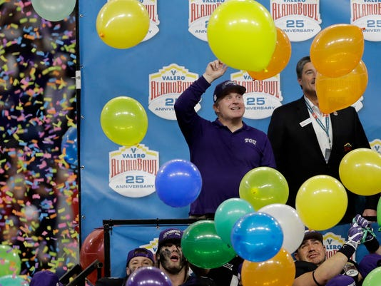 TCU coach Gary Patterson, left, celebrates with his team after a 39-37 win over Stanford in the Alamo Bowl NCAA college football game Thursday, Dec. 28, 2017, in San Antonio. (AP Photo/Austin Gay)