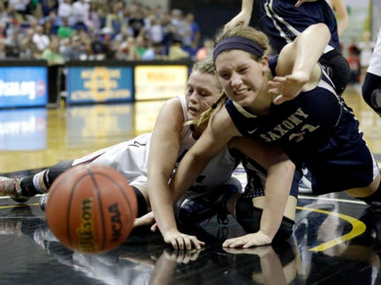 Saxony's Maddie Brune, right, and Strafford's Zoey Mullings dive after a loose ball as it goes out of bounds during the second half of the Missouri Class 3 girls high school championship basketball game Saturday, March 12, 2016, in Columbia, Mo. Strafford won 50-46. (AP Photo/Jeff Roberson)