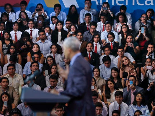 Members of the audience listen to US President Barack Obama speaking at a town hall with Young Leaders of the Americas Initiative (YLAI) in Lima, Peru, Saturday, Nov. 19, 2016.
