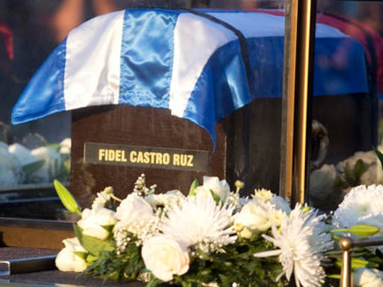 Placed in a small coffin covered by a Cuban flag, the ashes of Cuban leader Fidel Castro are driven along the streets of Havana, Cuba, Wednesday Nov. 30, 2016. Castro's ashes have begun a four-day journey across Cuba from Havana to their final resting place in the eastern city of Santiago.