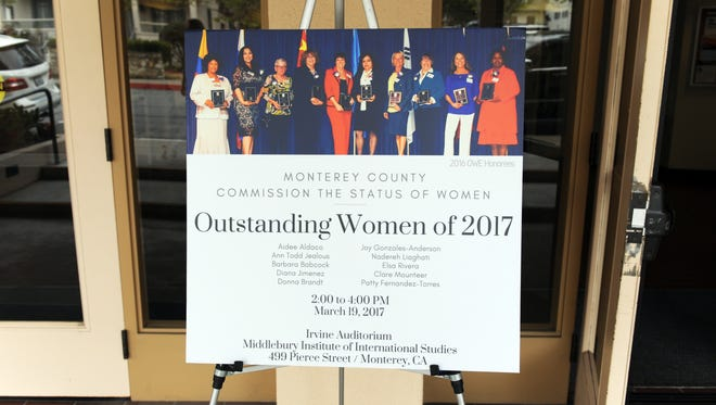 A placard at the entrance to Irvine Auditorium in Monterey announces SundayÕs event, the recognition of 2017Õs ten Outstanding Women of Monterey County.