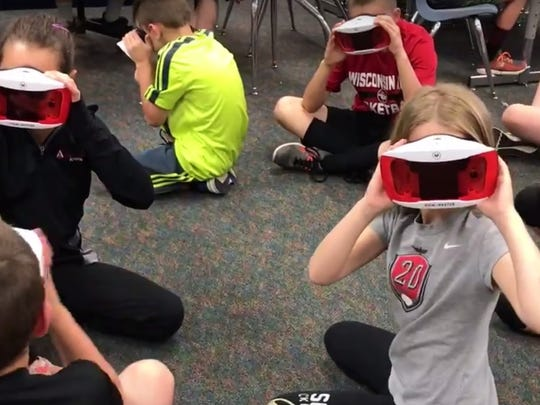 "Students test out a Google Expedition, transporting them to a ""virtual field trip."""