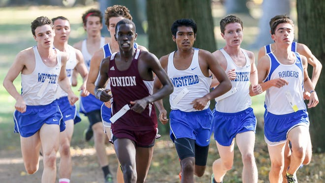 Union's Jonathan Mobisa leads a pack of Westfield and Scotch Plains runners in the Watchung Division race at the Union County cross country championships at Warinanco Park on October 18, 2016. Mobisa finished first but the Westfield team won the race with an average time of 17:25.80.