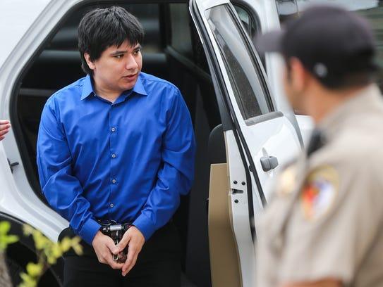 Isidro Delacruz, a capital murder suspect, arrives