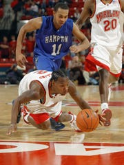 Andre Collins (2) of the Maryland Terrapins dives for