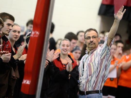 Sports reporter Steve Navaroli receiving a round of applause before the start of a swim meet at Dover Area High School Thursday, January 17, 2013.  DAILY RECORD/SUNDAY NEWS - KATE PENN