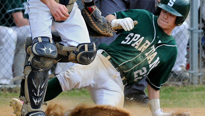Spackenkill's Billy Winnis slides safely into home ahead of the throw to the plate during his teams' game against Millbrook Wednesday in Poughkeepsie.