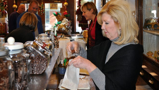 Peggy Penn at work during Small Business Saturday, Nov. 30, 2013, in Paducah, Ky.