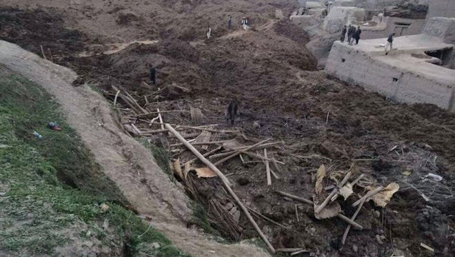 People search for survivors after a massive landslide landslide buried a village on May 2 in Badakhshan province, northeastern Afghanistan.