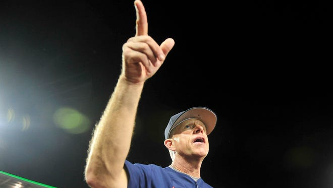 Vanderbilt coach Tim Corbin points to the fans after a 9-8 win over Virginia at the College World Series at TD Ameritrade Park in Omaha, Neb., Monday, June 23, 2014.