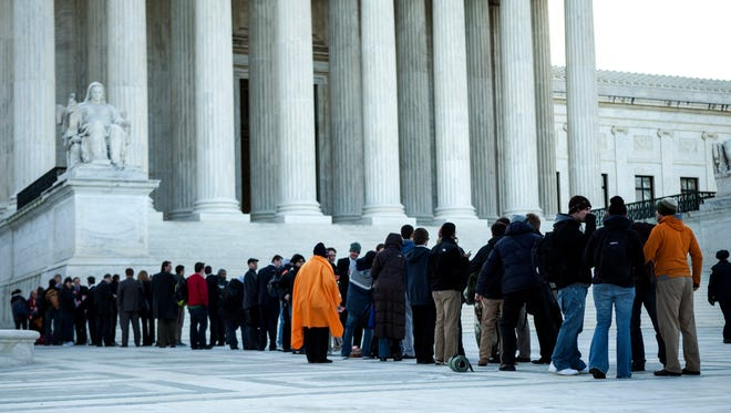 People line up outside the Supreme Court two years ago for oral arguments on the health care case.