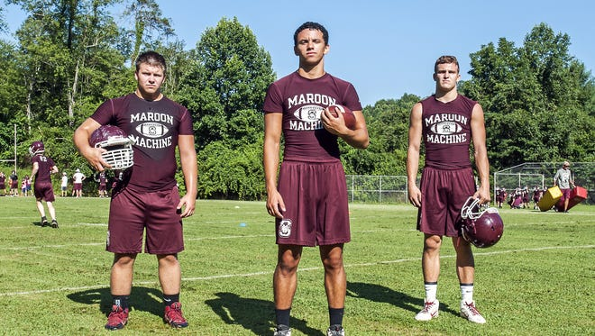 Swain County football players, from left to right, Craig Cutshaw, Angel Bowers and Jordan Cody.