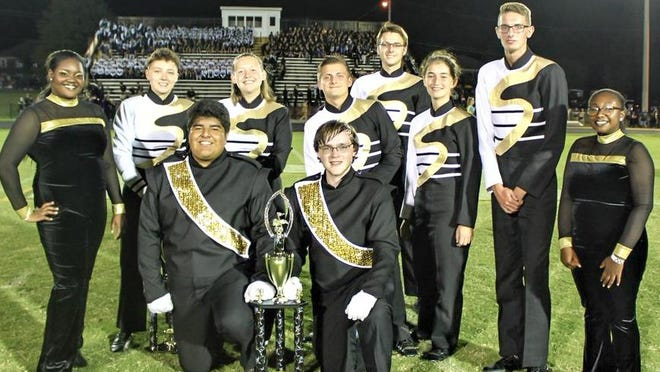 Members of the Springfield High School Band show off the trophy they won at the 30th annual Hendersonville Golden Invitational.