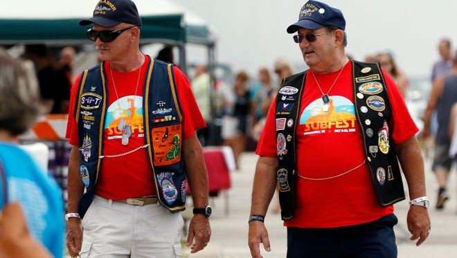 United State Submarine Veterans Inc. members John Wankowski, left, and Gerald Schoemann takes time at the Second Annual Subfest farmer's market on Saturday, July 9. Wankowski served on USS Flasher from 1969 to 1973 and Schoemann served on USS Redfin 1961 to 1965.