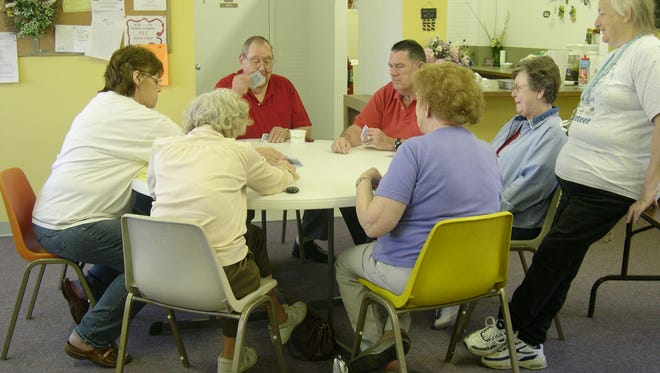 Local seniors are upset at changes at the Port Clinton Senior Center including the times seniors can play cards, such as this game from 2007.