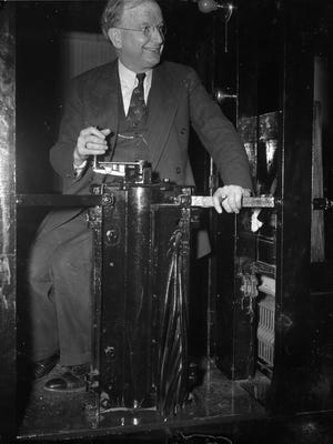 """Senator Burton Wheeler sitting at the controls of the senate subway car, cigar in hand. He refused to take part in World War I's """"sedition witch hunt."""""""