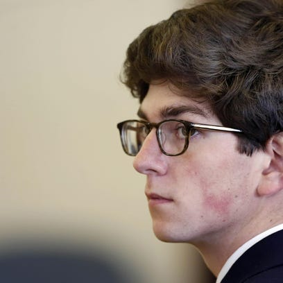 Owen Labrie listens as some of his former classmates