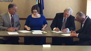 Leaders from Ingham, Eaton and Clinton counties and the Lansing Regional Chamber of Commerce signed an agreement Wednesday that shows their commitment to a regional partnership.