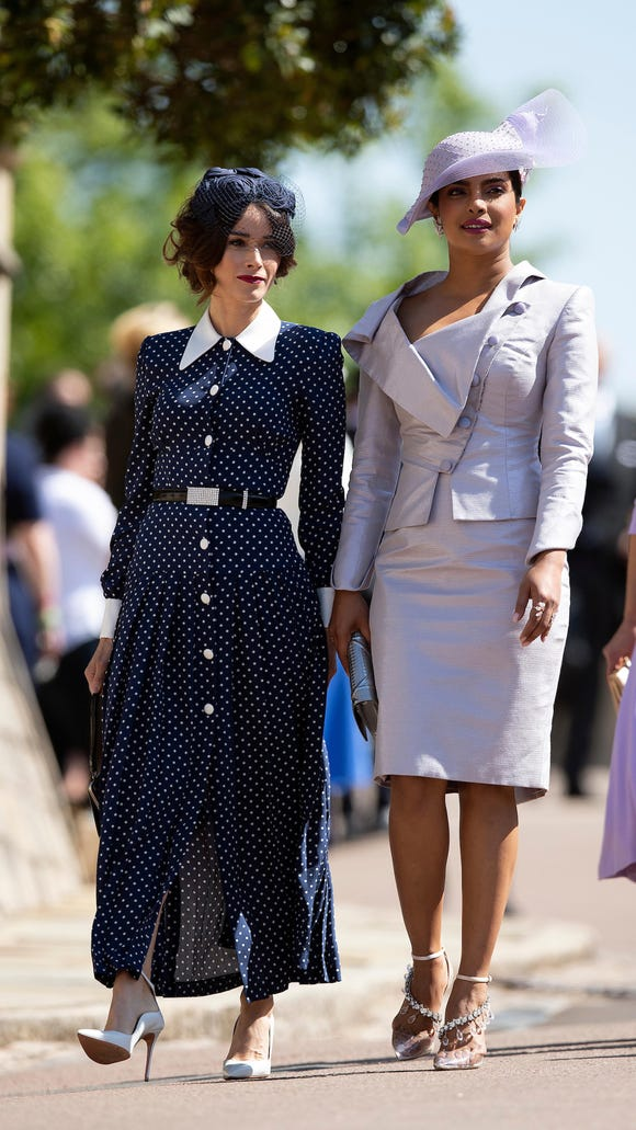 Television actresses Abigail Spencer (left) and Priyanka Chopra arrive for the royal wedding at George's Chapel at Windsor Castle on May 19.