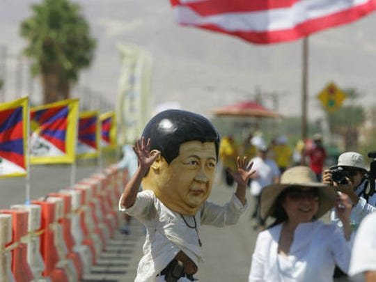 Protesters rally against Chinese President Xi Jinping's arrival to the Annenberg Retreat at Sunnylands for a binational summit with U.S. President Obama on June 7, 2013.
