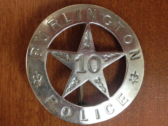 The oldest known Burlington police badge modeled after a traditional style sheriff's badge.