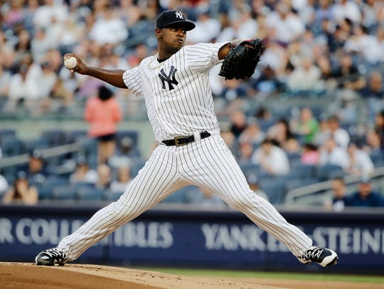 New York Yankees' Luis Severino delivers a pitch during