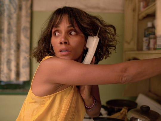 "In ""Kidnap,"" Karla (Halle Berry) calls the police for"