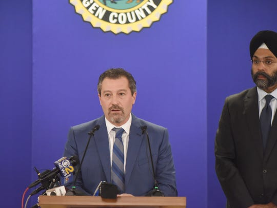 Chief Robert Anzilotti speaks at the news conference,